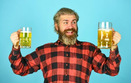 Hipster drink beer. Mature bearded guy hold beer glass. Cheers toast. True sensation. Holiday celebration. Bachelor day. Improve mood. Get drunk. Alcoholic. Thirsty man drinking beer in pub bar