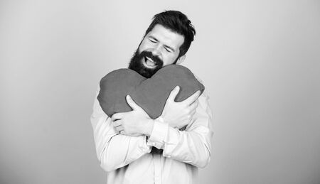 Happy in love. Make him feel loved every day. Man bearded hipster hug heart. Celebrate valentines day. Guy with beard and mustache in love romantic mood. Feeling love. Dating and relations concept