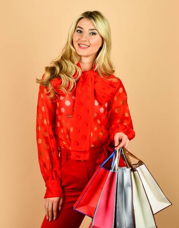sell-out on black friday. nice purchase. sexy blonde carry shopping bags. elegant girl shopaholic. shopper hold paperbag package. buy presents online. gift shop for any holiday. In shopping store Stock Photo