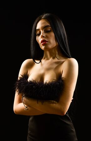 Seductive lady. Emphasize sexuality. Sexual hint. Beautiful decollete. Fashion concept. Fancy clothes. Fashion shop. Attractive woman fashion model. Fashionable girl wearing dress with feathers