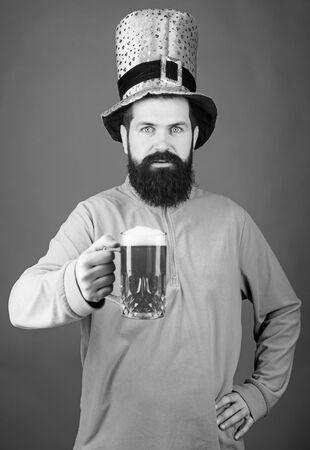 Irish pub. Drinking beer part celebration. Bar seasonal holiday menu. Green beer mug. Cheers. Alcohol beverage. Lets start patricks party. Irish tradition. Man brutal bearded hipster drink pint beer