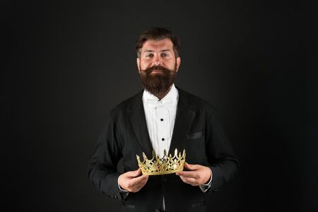 Now come and make it worth. Crown in hands. Handsome man give crown black background. Getting reward. Crowning glory. Glory and ambitions. King crown. Royal coronation symbol. Reputation and status