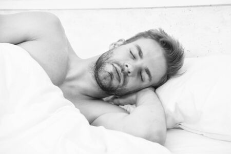 Enough amount sleep every night. Health care concept. Circadian rhythm regulates sleep wake cycle. Man handsome unshaven guy in bed. Tips sleep better. Bearded man relaxing on pillow. Soft pillow