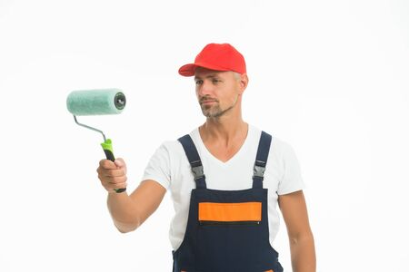 Interested in design and decor. Interior decorator isolated on white. Painter decorator hold paint roller. Skilful decorator or handyman. Painting and decorating work. House decorator
