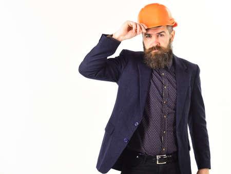 Builder in suit and helmet on white background Reklamní fotografie