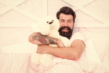 Soft cotton bedclothes. Enough amount sleep every night. Comfort and relax. Tips sleep better. Bearded man relaxing. Circadian rhythm is natural internal process that regulates sleep wake cycle.