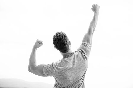 Happy winner. muscular back man isolated on white. Launch own business. Business success. guy feel powerful going to change world. We are winners. thankful man for fortune