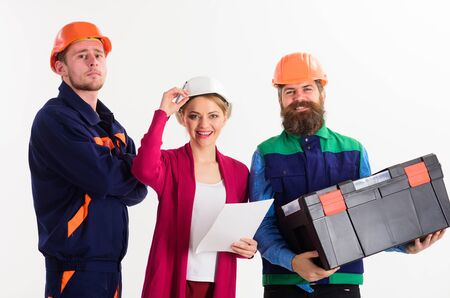 Team of builders concept. Men and woman in hard hats