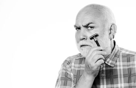 shaving razor blade tool kit. mature bearded man isolated on white. unshaven old man has moustache and beard. cut and brush hair. barbershop concept. shaving accessories. copy space