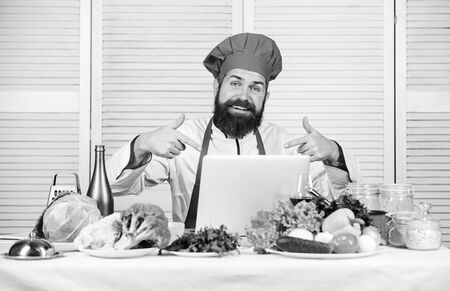 Healthy food cooking. Mature hipster with beard. Happy bearded man. chef recipe. Cuisine culinary. Vitamin. Vegetarian salad with fresh vegetables. Dieting organic food. Fresh funky