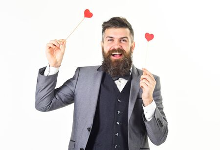 Hipster wears smart suit and bow-tie. Dating, love, fashion, style, emotions, feelings, flirt concept.