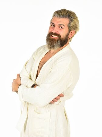 Enjoying time at home. good morning. male health care and spa. time to relax. home day on weekend. brutal bearded hipster isolated on white. feeling cozy and comfortable. man in bathrobe after shower