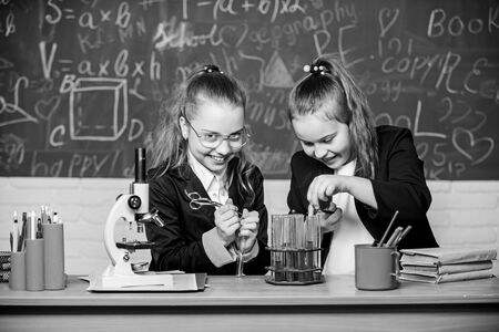 science experiments in chemistry laboratory. Little scientist work with microscope. Biology lesson. Chemistry research. Little girls in school lab. Medicines you can trust. Chemistry education