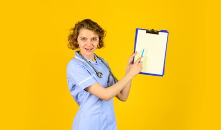 look here. therapist in uniform at hospital. medical history and prescription. Professional doctor holding folder. happy young nurse holding clipboard. female medical doctor use stethoscope