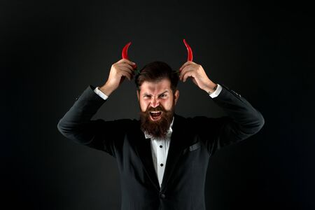 his true essence. he is devil in business. businessman has red pepper horn. barbershop hell concept. peppery male fashion. Stubborn and purposeful. brutal man prefer strong chilli. i will be demon
