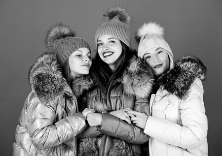 true embraces. girls in beanie. flu and cold. seasonal shopping. happy winter holidays. Friendship. women in padded warm coat. family christmas. winter clothing fashion. faux fur down jacket