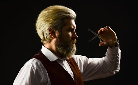 Barbershop. Hipster Barber. Vintage style man with beard and moustache. Mature man with dyed hair. Vintage barbershop. Barber tools. Barbershop services. Keep yourself looking groomed all year round.