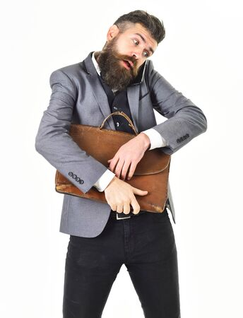 Busy man with briefcase talking by mobile phone