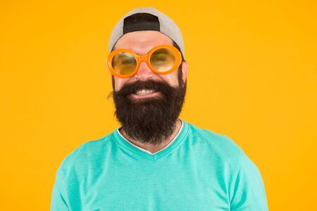 Fun and entertainment. casual hipster outfit. funny man having fun. bearded guy in party glasses. just like a freak. he is going crazy. summer male fashion. happy and smiling hipster