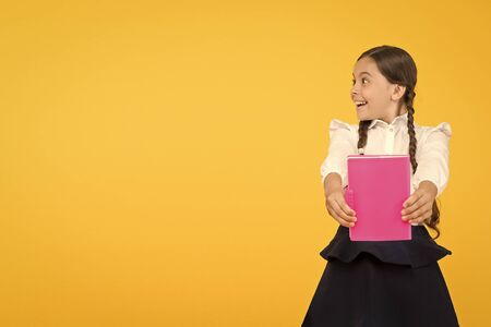 Kid student ready with homework. School girl excellent pupil prepared essay or school project. Raising independence. Schoolgirl wear school uniform. Knowledge day. Girl with copy book or workbook 스톡 콘텐츠