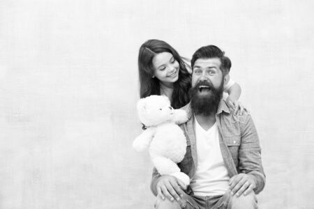Best friends forever. Father and daughter play with soft toy. Small child and dad enjoy friendship. Happy friends. Playing games. Friends and family. Friends complement each other, copy space