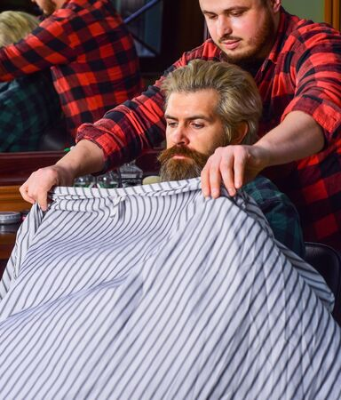 Male barber care. barber with male client. hipster with dyed beard and moustache. man want new hairstyle. male beauty and fashion. mature man at barbershop. brutal bearded man at hairdresser