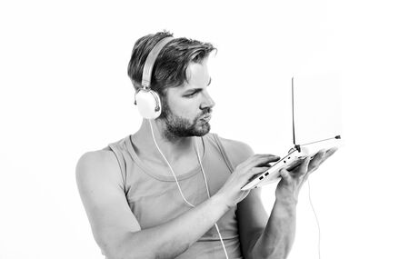 web blog. relax playlist. sexy muscular man listen music from playlist. man relax in earphones isolated on white. unshaven man relax with favorite song Stock Photo