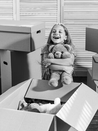 Urban Location. happy little girl with toy. purchase of new habitation. Moving concept. new apartment. happy child cardboard box. Cardboard boxes - moving to new house