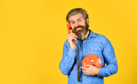vintage stationary telephone. hello 80s. Man with moustache holding vintage phone. vintage communication device. Businessman talking on vintage phone in his office. agile business. copy space Фото со стока