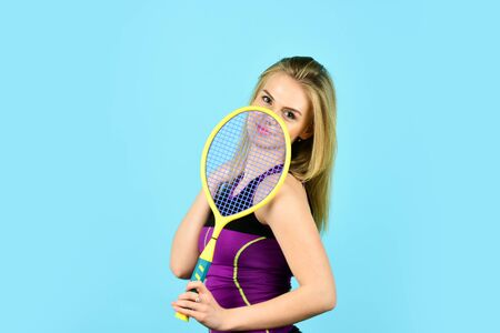 Sport and recreation concept. young woman playing tennis. Playing Badminton On A Badminton Court. Racket sports are games. beach tennis game. smiling woman training. Playing Tennis One to One Stock Photo