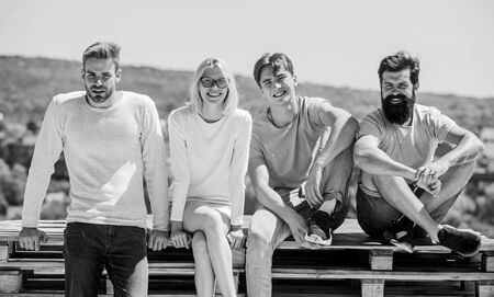 Just smile. happy men and girl relax. group of four people. great fit for day off. Group of people in casual wear. diverse young people talking together. best friends. Summer vacation