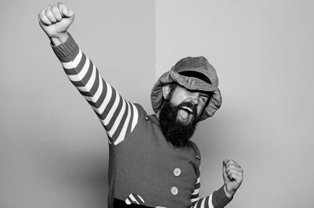 St Patricks day. Hipster with beard wearing green costume for party. Cheerful man celebrate holiday. Christmas elf. Elf concept. Traditions or customs. Happy celebration. Bearded elf. Winter carnival
