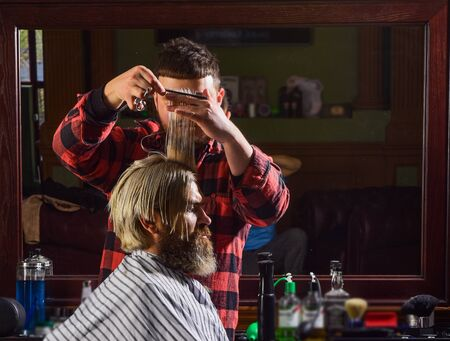 Donate hair. Sharp object near face and squirming distracts person holding it. Donation and charity concept. Guy with dyed blond hair. Cut hair. Barber hairstyle barbershop. Hipster getting haircut
