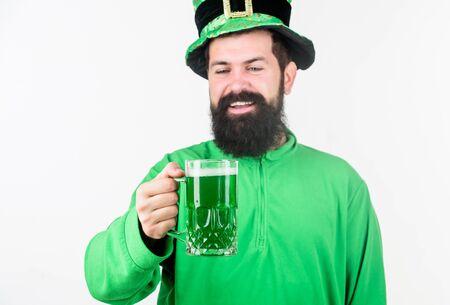 Instant irish just add beer. Bearded man toasting to saint patricks day. Irish man with beard drinking green beer. Hipster in leprechaun hat holding beer mug. Celebrating saint patricks day in bar Zdjęcie Seryjne
