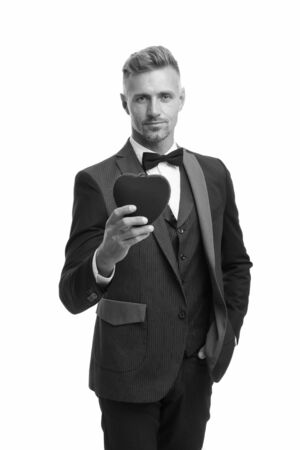 Generous man. Man mature handsome guy wear elegant suit hold red heart. Valentines day celebration. Romantic surprise. Celebrate valentines day. Prepare gift for valentine. Love date anniversary Banco de Imagens