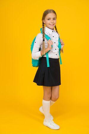 knowledge day. childhood development. school girl wear uniform. pretty little girl ready to study. back to school. education online at quarantine. learning bring future success. Feeling so carefree Фото со стока