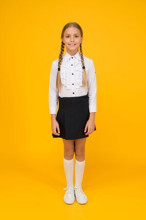 school girl wear uniform. pretty little girl ready to study. back to school. education online while quarantine. learning well ring successful future. knowledge day. childhood development