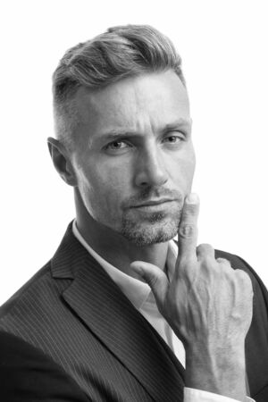 Portrait of mature macho. Gentleman hipster hairstyle. Barber shop concept. Beard and mustache. Guy well groomed handsome macho tuxedo. Hipster groom. Serious glance. Attractive mature hipster
