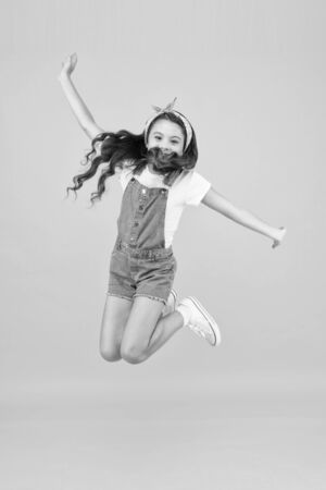 Spirit of freedom. Active girl feel freedom. Fun and relax. Feeling free. Carefree kid. Summer holidays. Jump of happiness. Small girl jump yellow background. Enjoy freedom. Childrens day concept