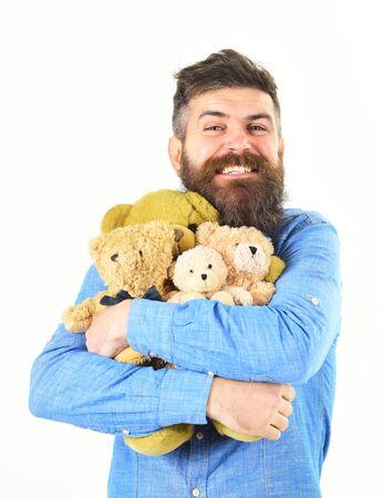 lovely portrait of man cuddling teddy bears Reklamní fotografie