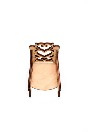 Chair with vintage pattern. Toy chair made of wood, top view. Tiny armchair for children to play. Little furniture concept