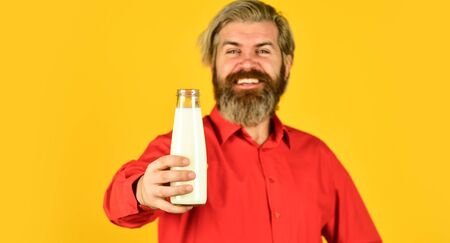 bearded man drink useful milk. unsweetened coconut almond blend milk. Healthy useful vegan drink. Useful replacement meat is soy milk. happy farmer present milk glass Banco de Imagens