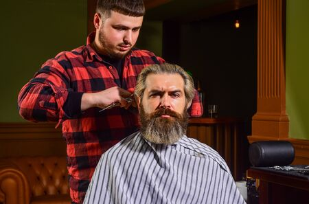 Donate hair. Donation and charity concept. Guy with dyed blond hair. Cut hair. Barber hairstyle barbershop. Hipster getting haircut. Sharp object near face and squirming distracts person holding it