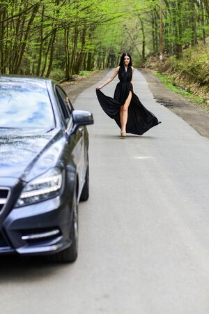 Status and respect. Rich people lifestyle. Start journey. Luxury car. Auto and pretty sexy woman at road. Travel concept. Traveling and vacation. Transport concept. Travel by car. Auto service Stock Photo