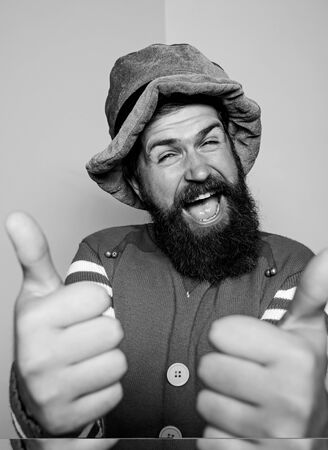 thumb up for success. Winter carnival. irish pub party. st patricks day. happy bearded hipster in green hat. christmas elf. happy celebration. cheerful man with beard have fun. ireland beer tradition Standard-Bild