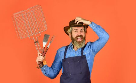 Picnic and barbecue. Steak and barbecue. Barbecue. Grilling food. American picnic. Family tradition. Cooking meat. Spring season. Bearded farmer wear hat and apron for barbecue. Roasting meat