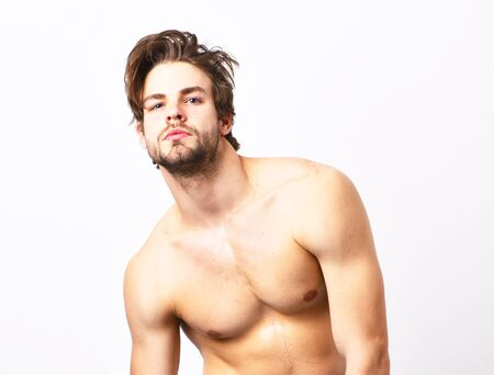 Man with beard and naked torso on white background.