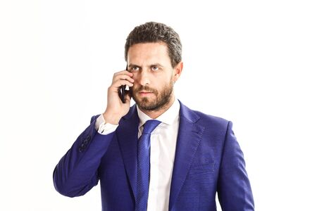Man with beard in classic suit or businessman with smartphone