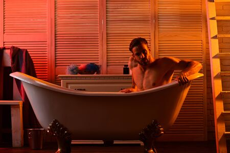 Guy in bathroom with romantic light and stairs on background