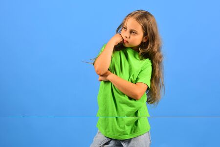 Child looks like hip hop star wearing casual clothes.